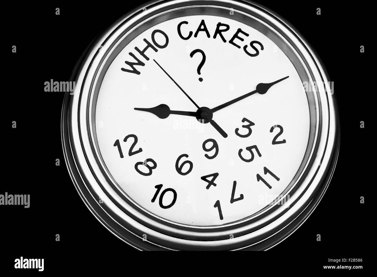 A black and white  image of a clock with numbers falling off showing the concept of time doesn't matter - Stock Image