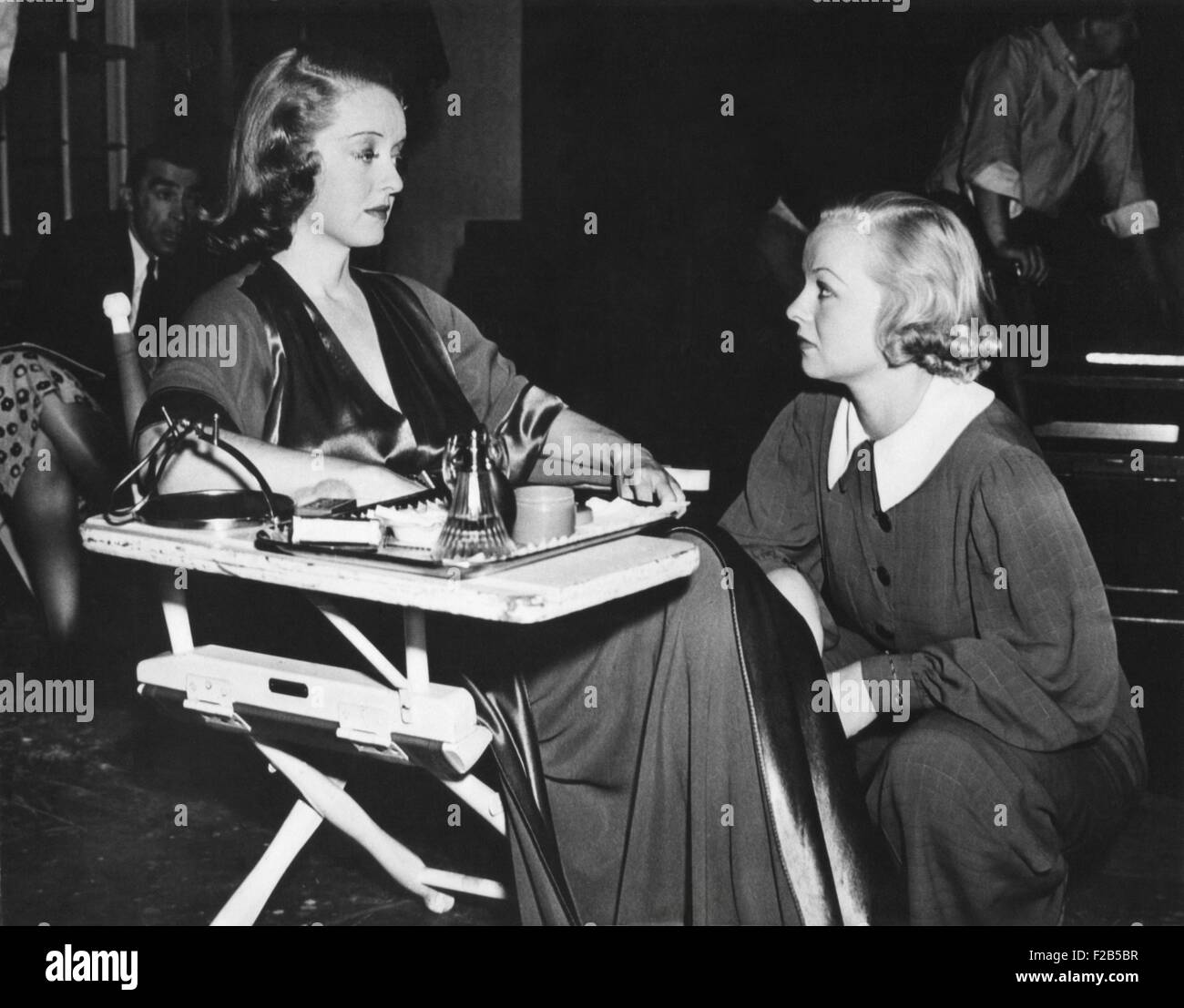 Betty Davis with her stand-in Sally Sage on the set for 'That Certain Woman'. Sage worked as a stand-in - Stock Image