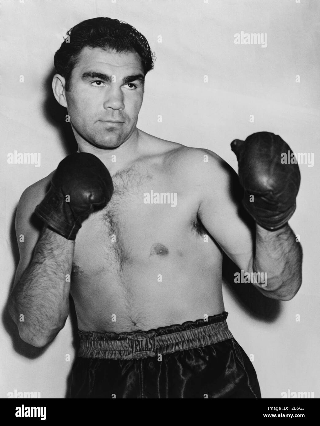 German boxer Max Schmeling in a boxing pose in 1938. On June 22, 1938 he lost in a rematch with American Joe Louis. - Stock Image