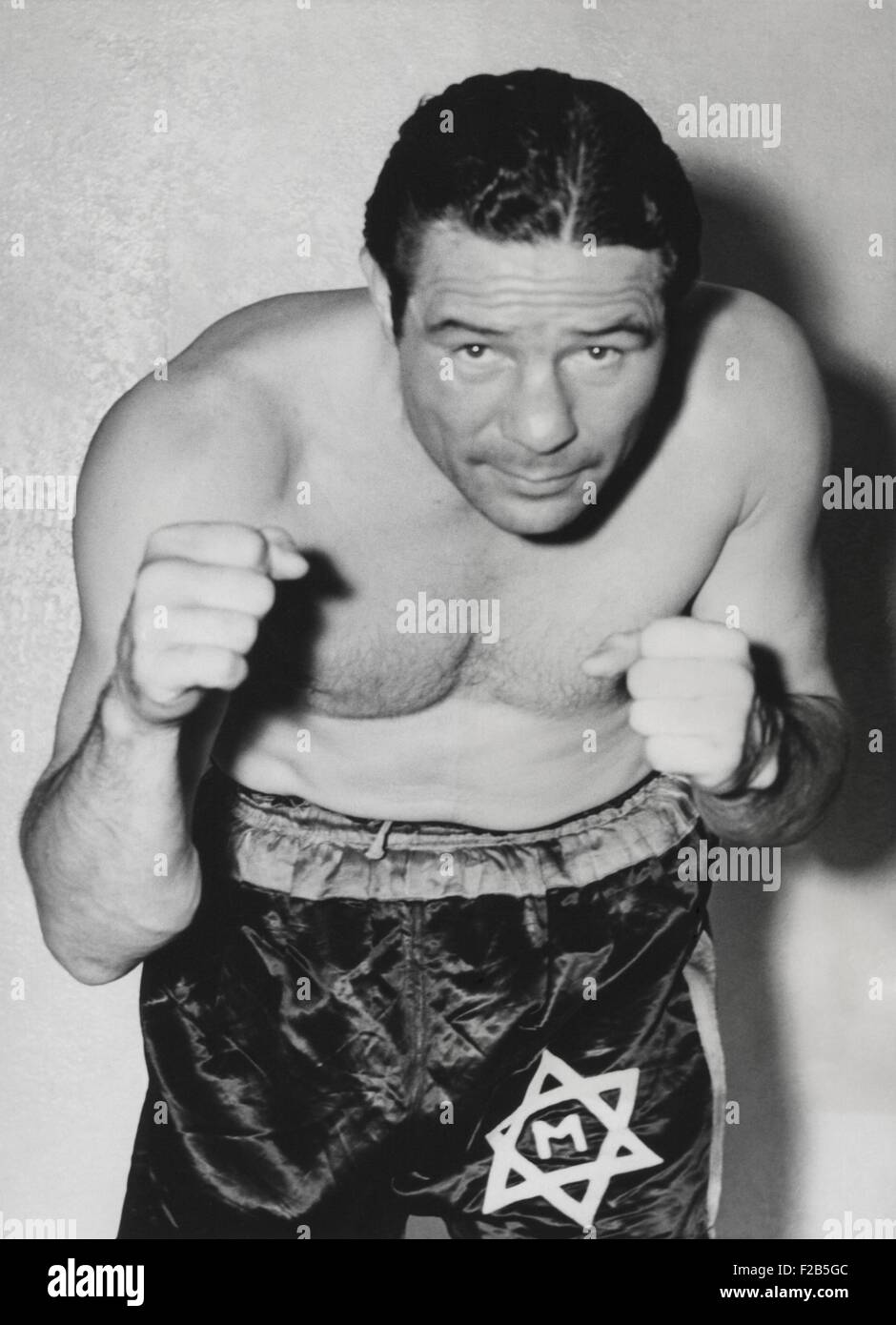 Max Baer, former World Heavyweight Champion preparing for a bout with Lou Nova. Baer lost the Yankee Stadium fight - Stock Image