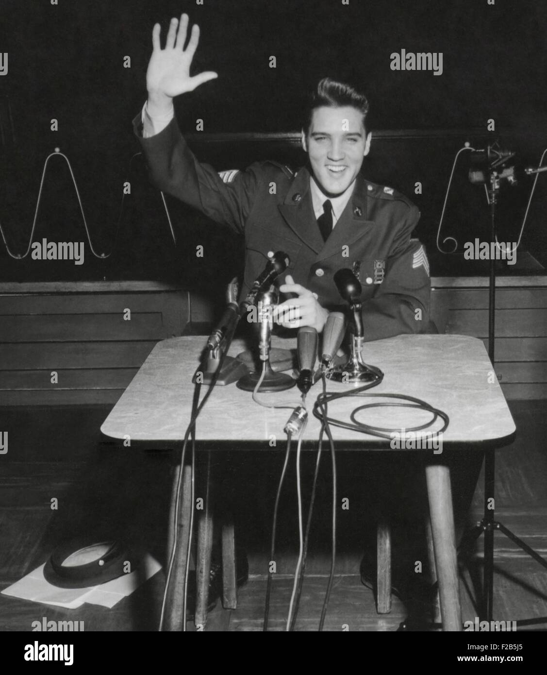 Sgt. Elvis A. Presley answers question for the civilian and military press. March 1, 1960. When asked why he served - Stock Image