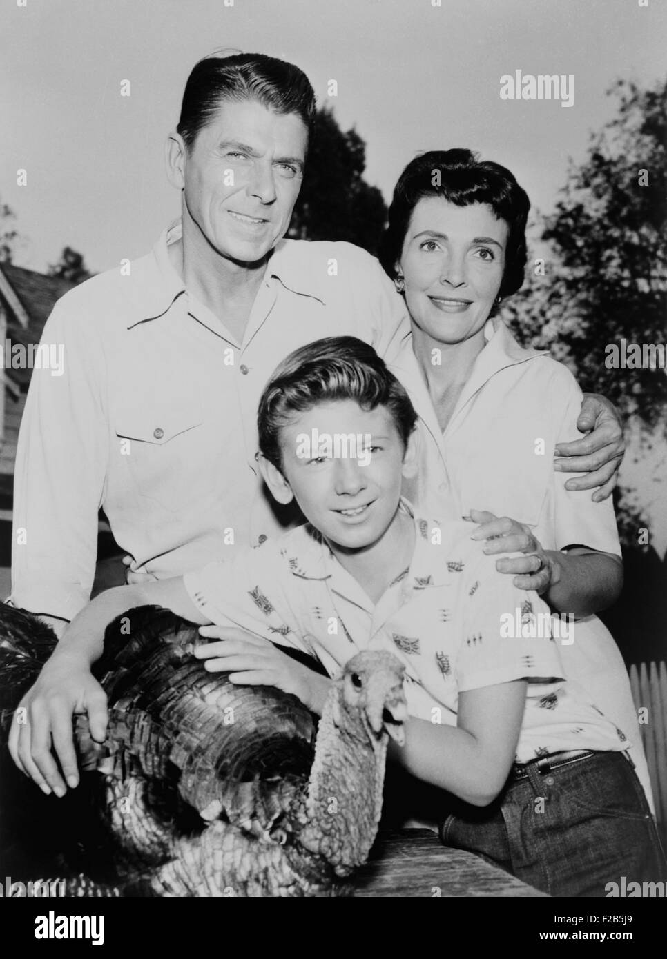 Nancy Davis, Ronald Reagan, Tommy Nolan and a live turkey pose for G.E. Theater publicity photo. 1958. - (BSLOC - Stock Image