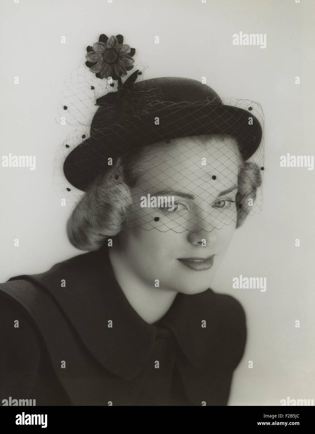 Grace Kelly modeling a veiled hat at age 19 in 1949. She was studying at the American Academy of Dramatic Arts in - Stock Image