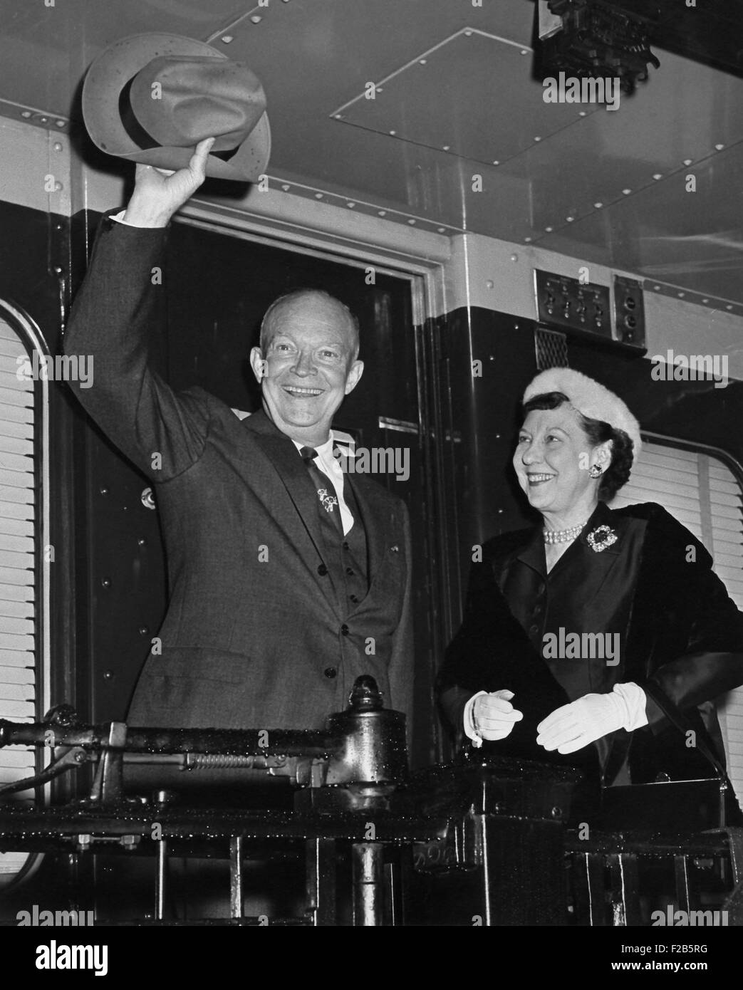 Dwight and Mamie Eisenhower waving from the 1956 campaign train. - (BSLOC_2014_16_78) - Stock Image