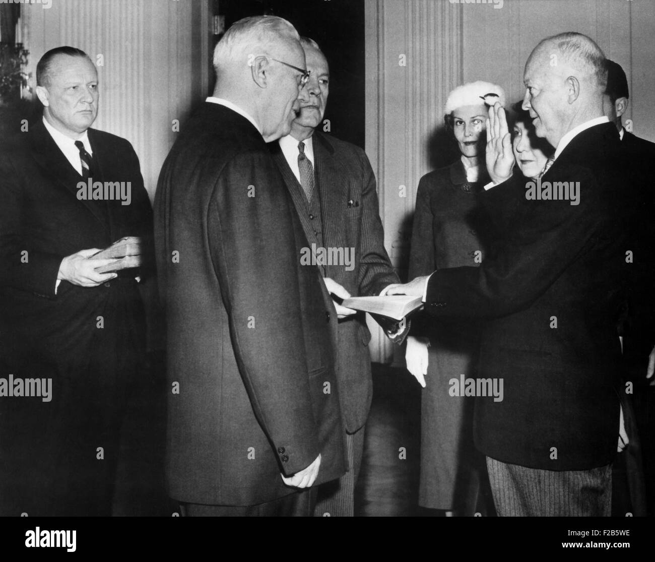 Dwight Eisenhower taking oath of office in a private ceremony in the East Room of the White House. The ceremony - Stock Image