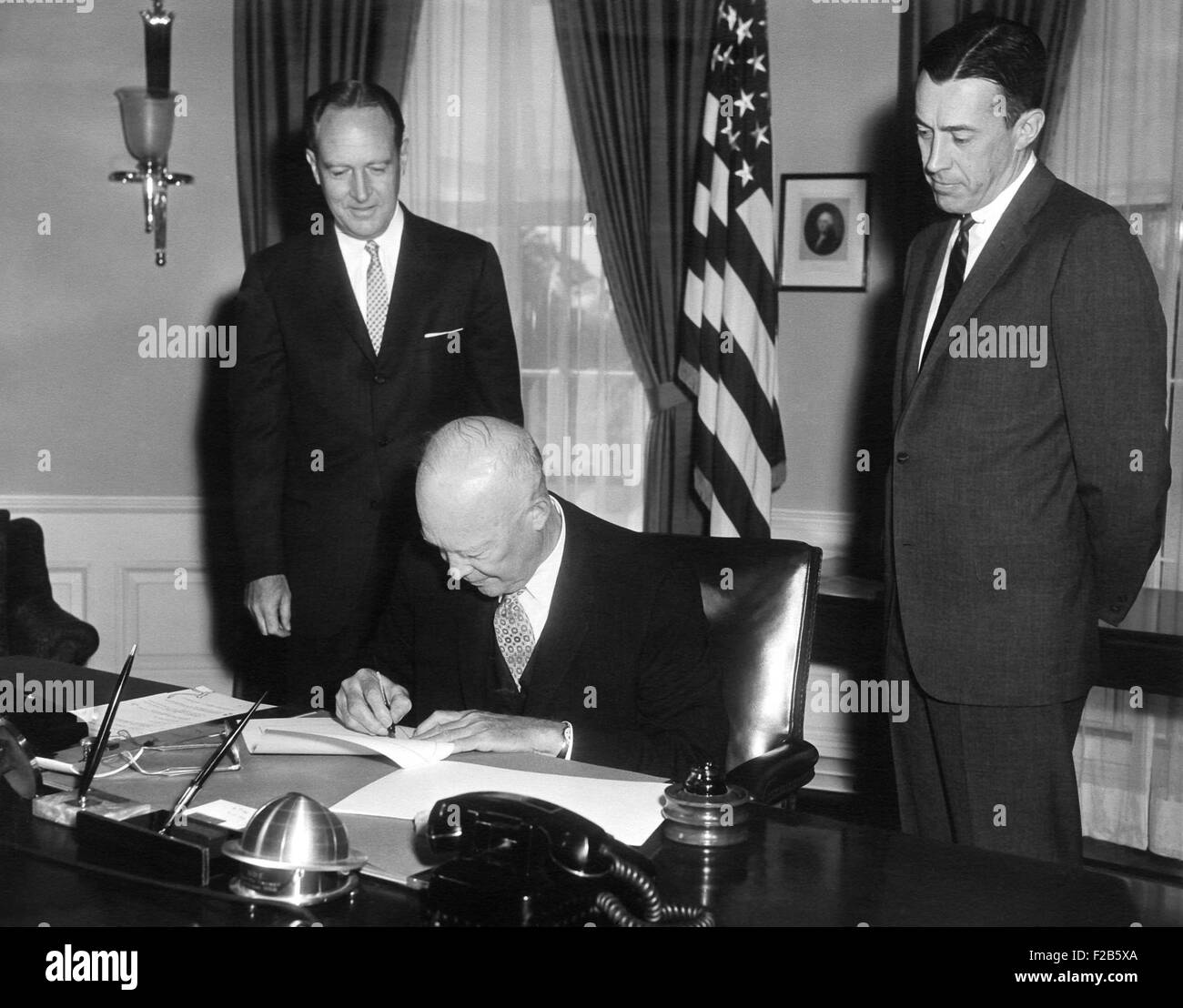 President Eisenhower signing the Civil Rights Bill of 1960. May 6, 1960. The law established federal inspection - Stock Image