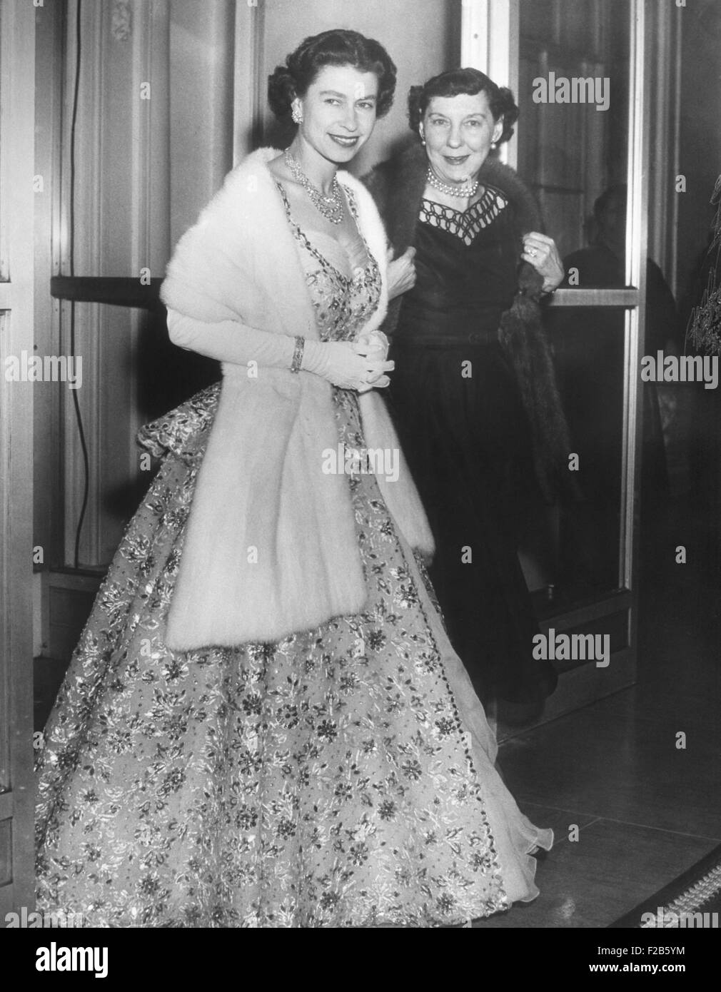 Queen Elizabeth II and Mamie Eisenhower in evening gowns at the British Embassy. Oct. 19, 1957. - (BSLOC_2014_16 - Stock Image