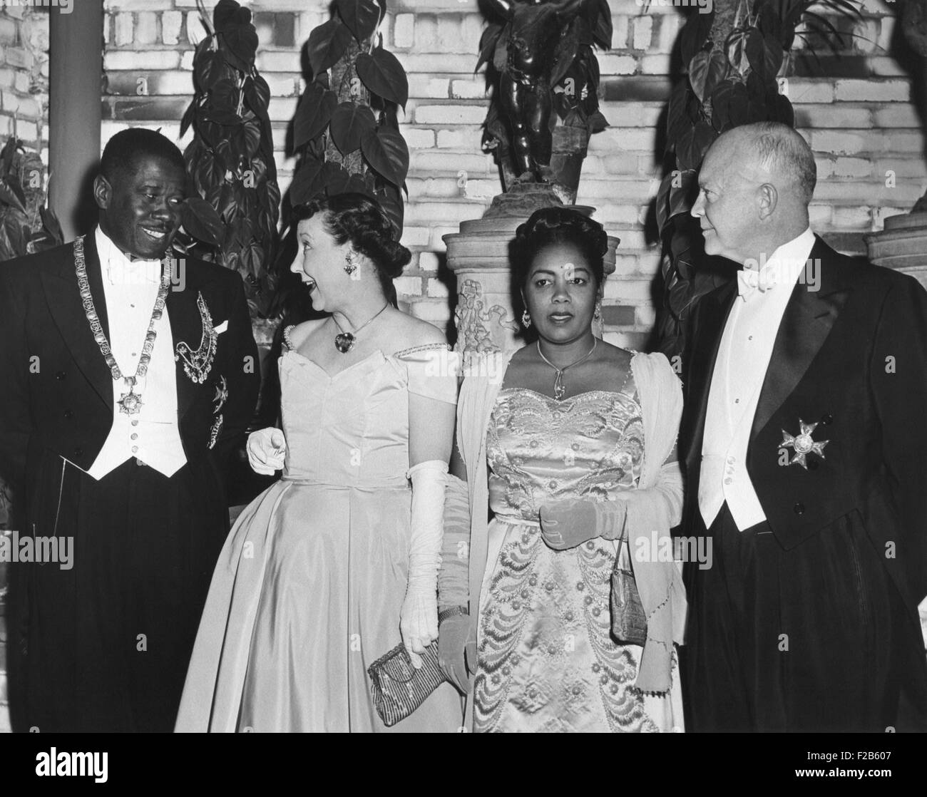 President and Mamie Eisenhower at a dinner in their honor given by Pres. And Mme. Migliori of Haiti. Sheraton Park - Stock Image