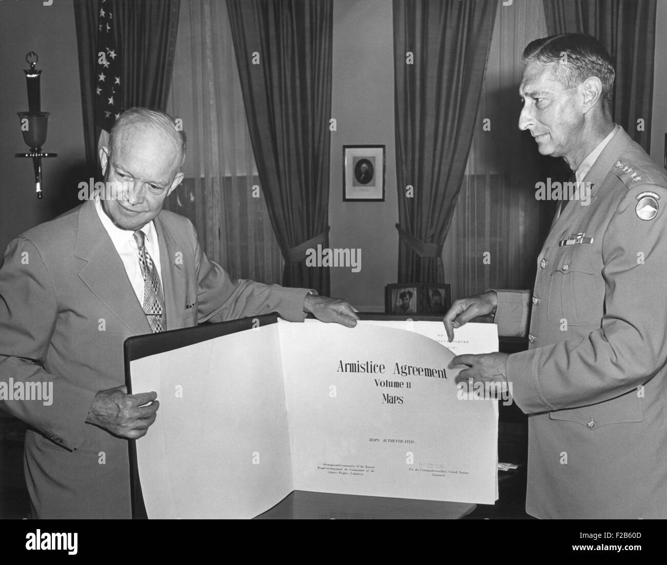 President Eisenhower with General Mark Clark displaying the Korean War Armistice Agreement. The bound volume of - Stock Image