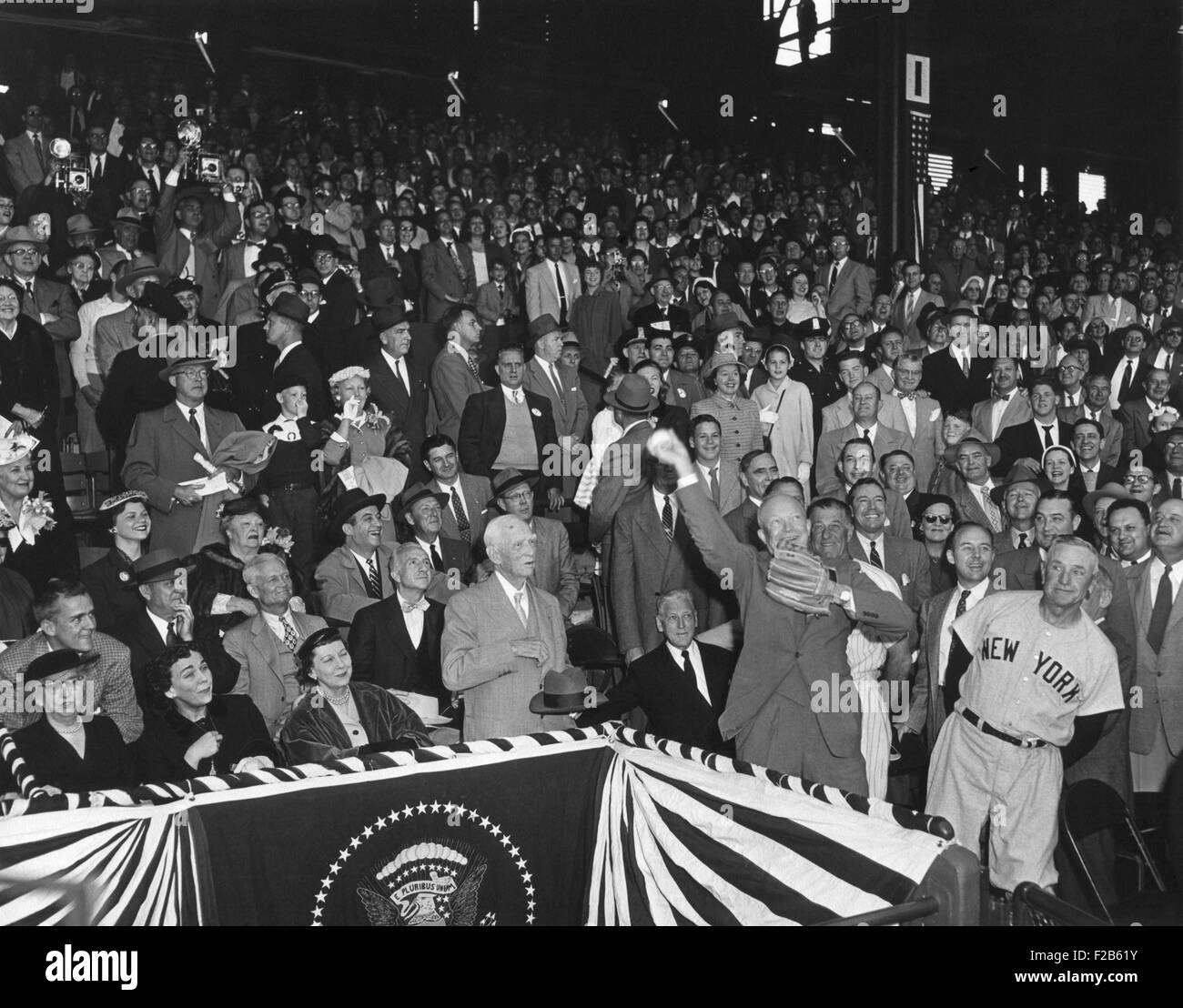 President Eisenhower throwing out the first ball of the 1954 Baseball season at Griffith Stadium. At left is Casey - Stock Image