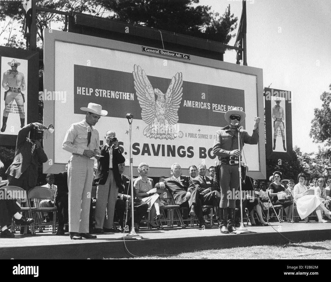 Actor Clayton Moore in his Lone Ranger character promotes U.S. Savings Bonds. Washington, D.C. June 17, 1958. - - Stock Image