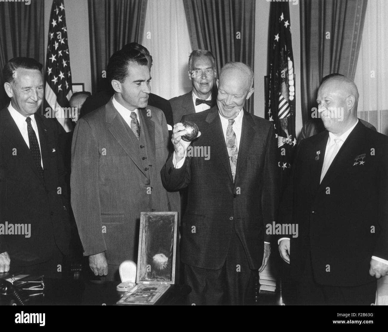 President Eisenhower holding a gift from Soviet Premier Nikita Khrushchev. It was a replica of metal ball, 7.5 cm - Stock Image