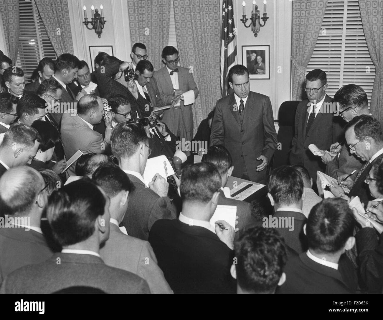 Vice President Richard Nixon with reporters on Nov. 27, 1957. Nixon answered questions about Eisenhower's mild - Stock Image