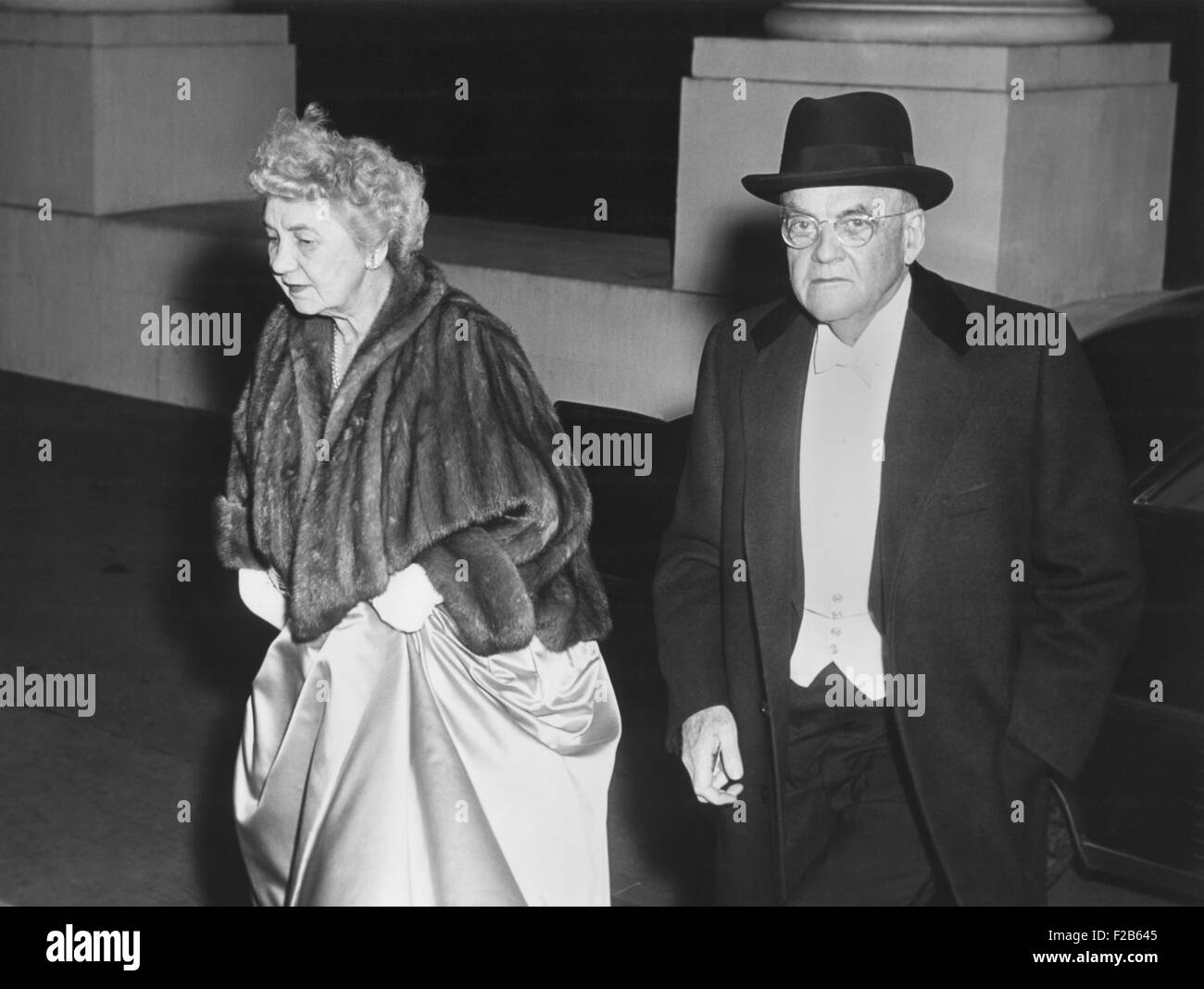 Sec. of State John Foster Dulles and his wife, arriving at state dinner for Queen Elizabeth II. Oct 17, 1957. - - Stock Image