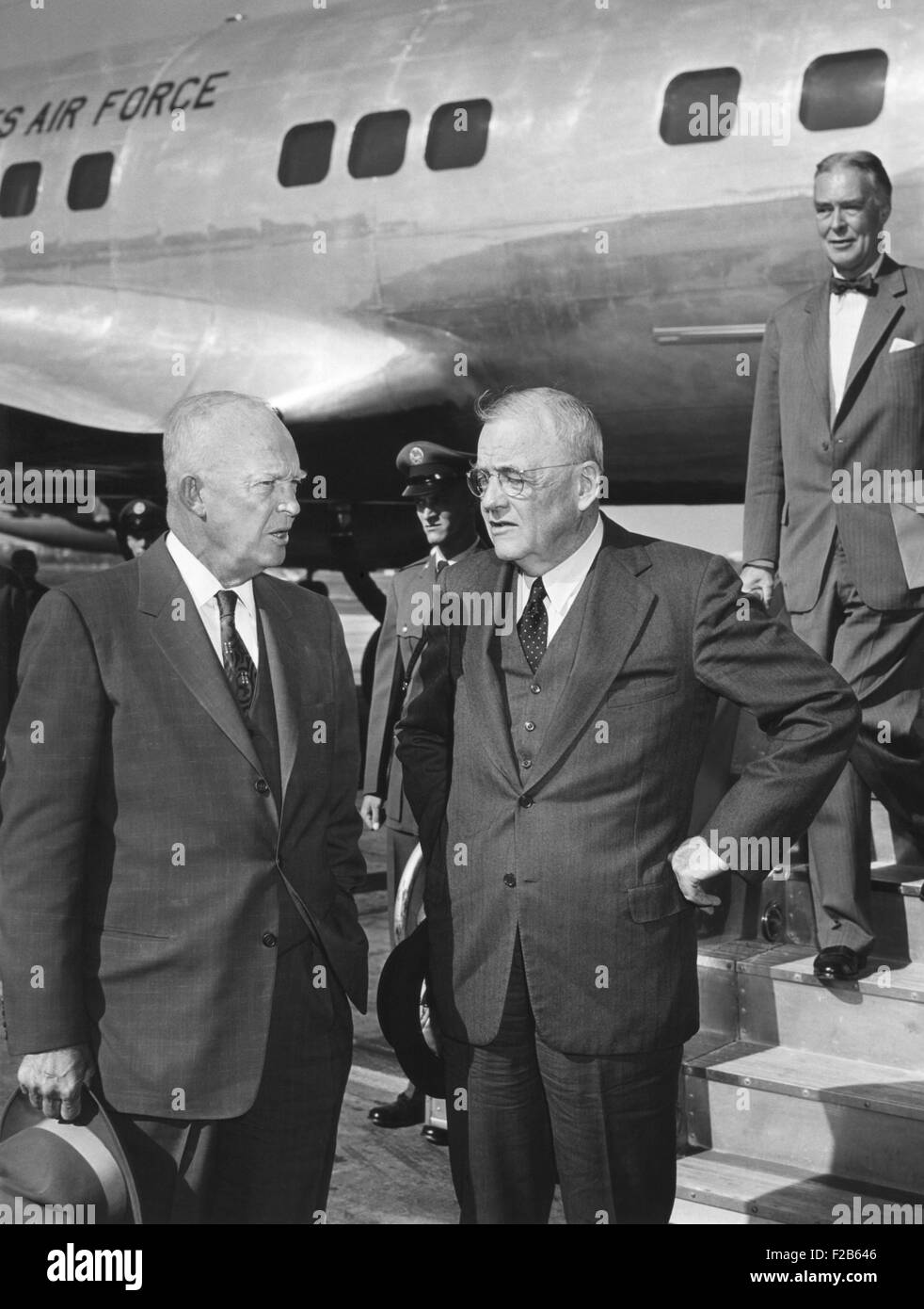President Eisenhower was met by Sec. of State John Foster Dulles at Washington National Airport. Eisenhower was - Stock Image