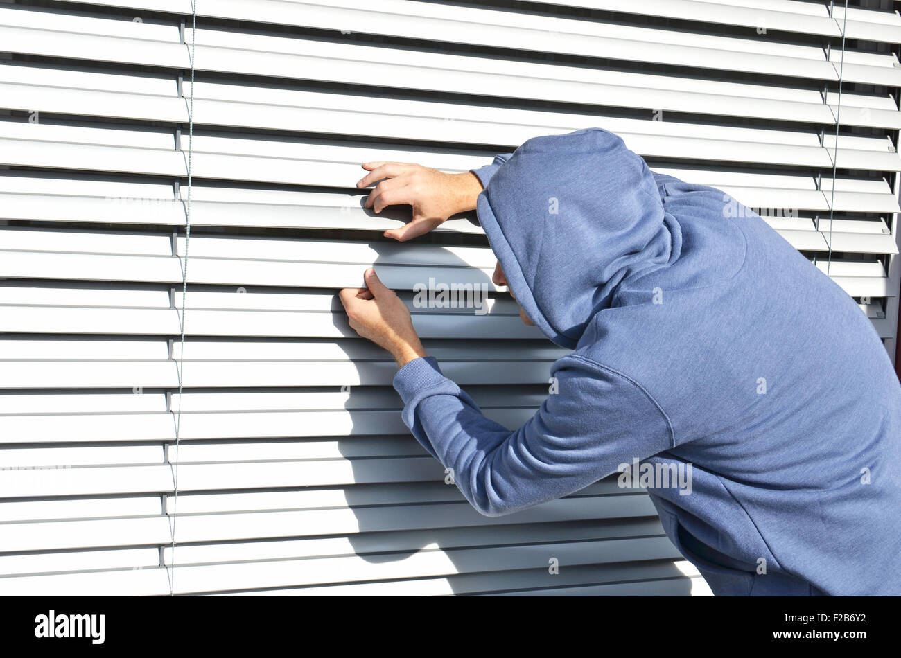 Thief at the window - Stock Image