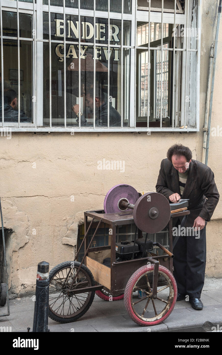 A Knife-grinder  in a  side street in Eminonu, Istanbul, Turkey. - Stock Image