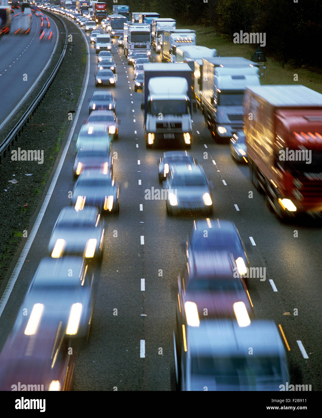 Bumper-to-bumper, nose-to-tail heavy traffic. - Stock Image