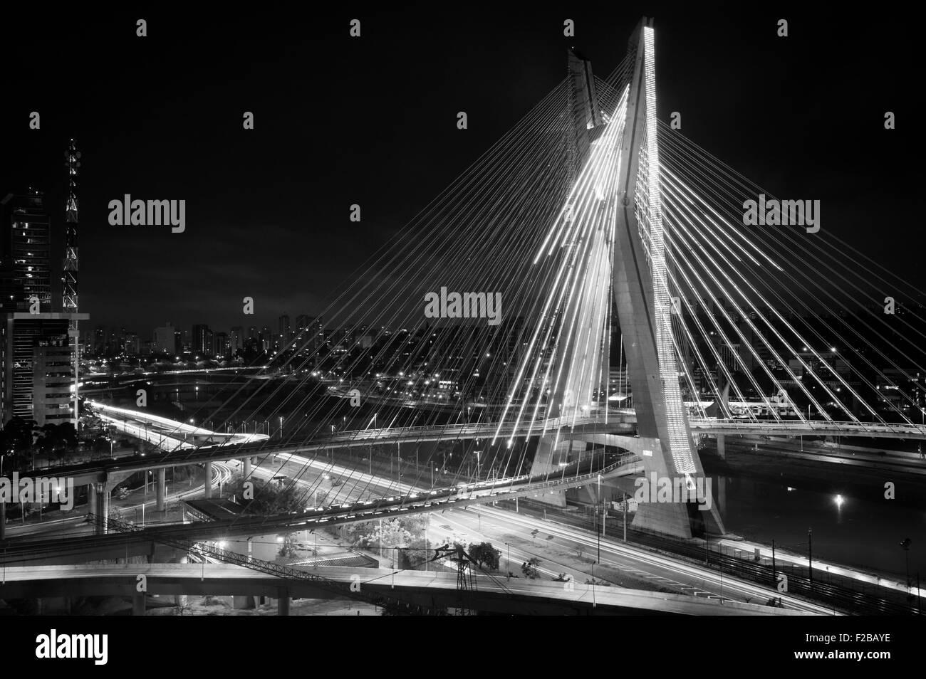 Most famous bridge lit up in the city at night, Octavio Frias De Oliveira Bridge, Pinheiros River, Sao Paulo, Brazil - Stock Image