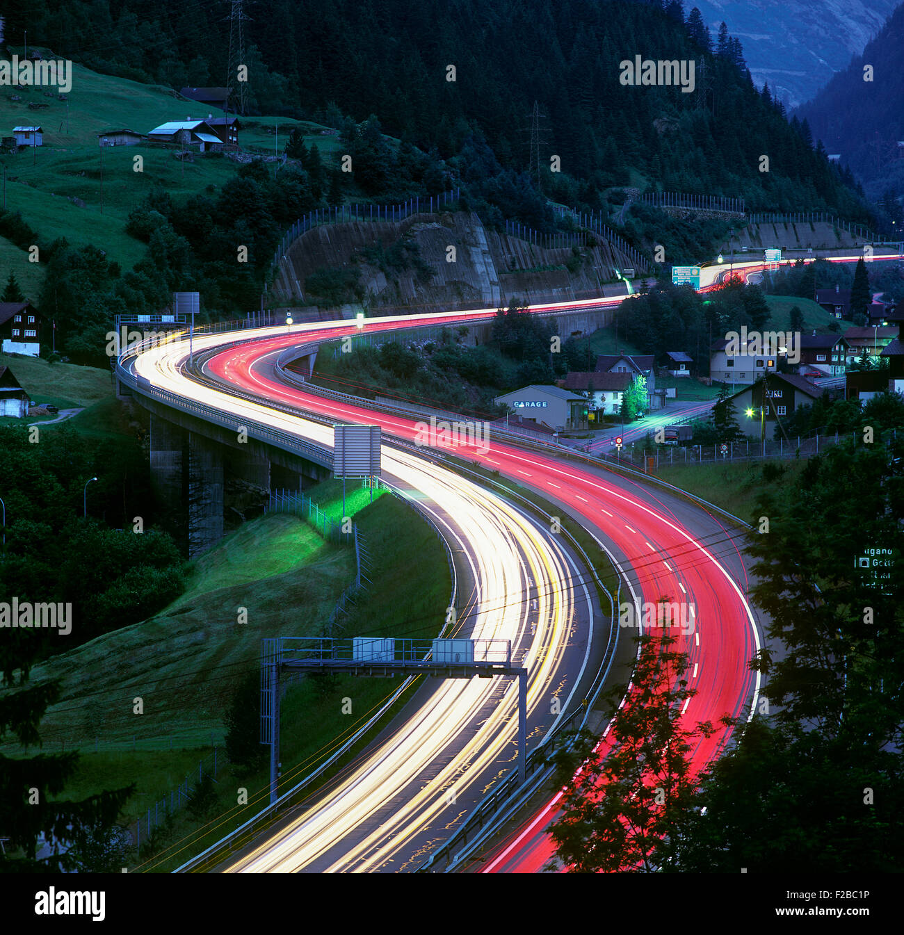Night view of light trails on the Swiss A2 motorway near Wassen, looking south towards the St Gotthard tunnel. Stock Photo