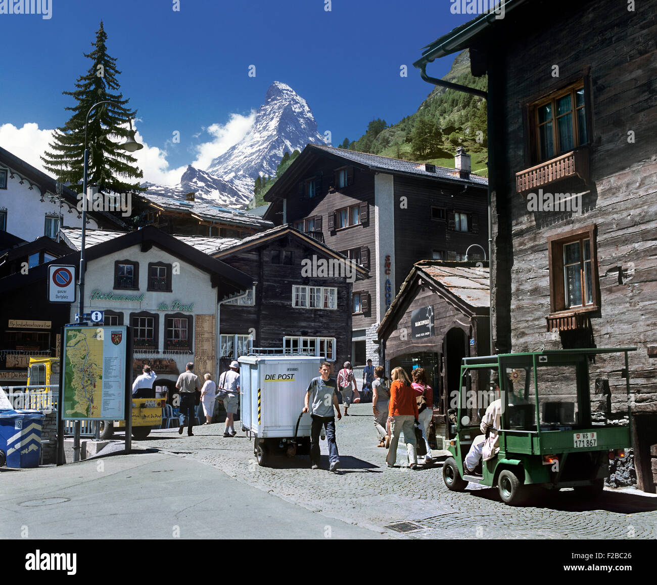 A battery-powered electric handcart, for delivering the post, being steered through the car-free streets of Zermatt, - Stock Image
