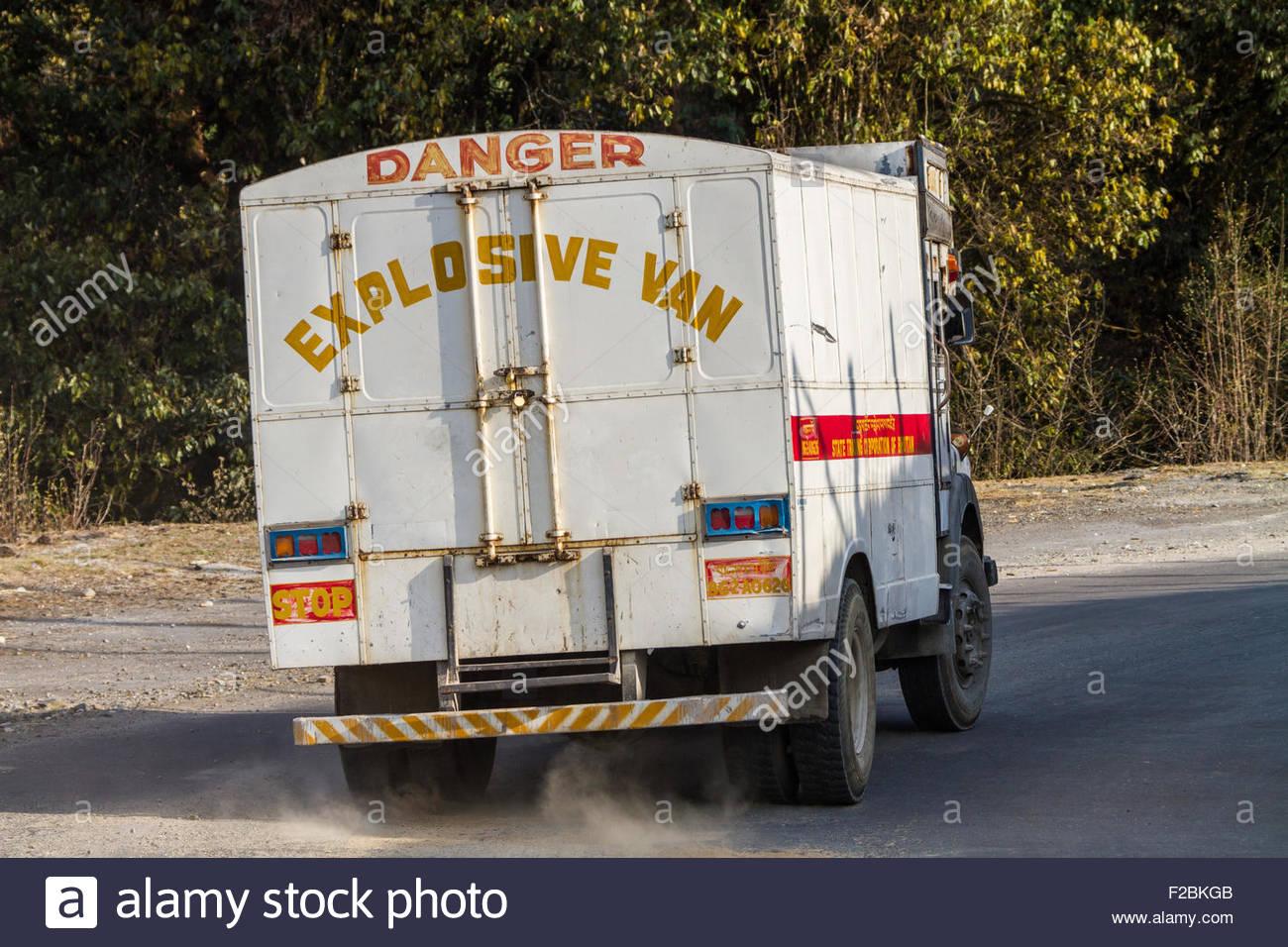 An Explosives truck drives through central Bhutan - Stock Image