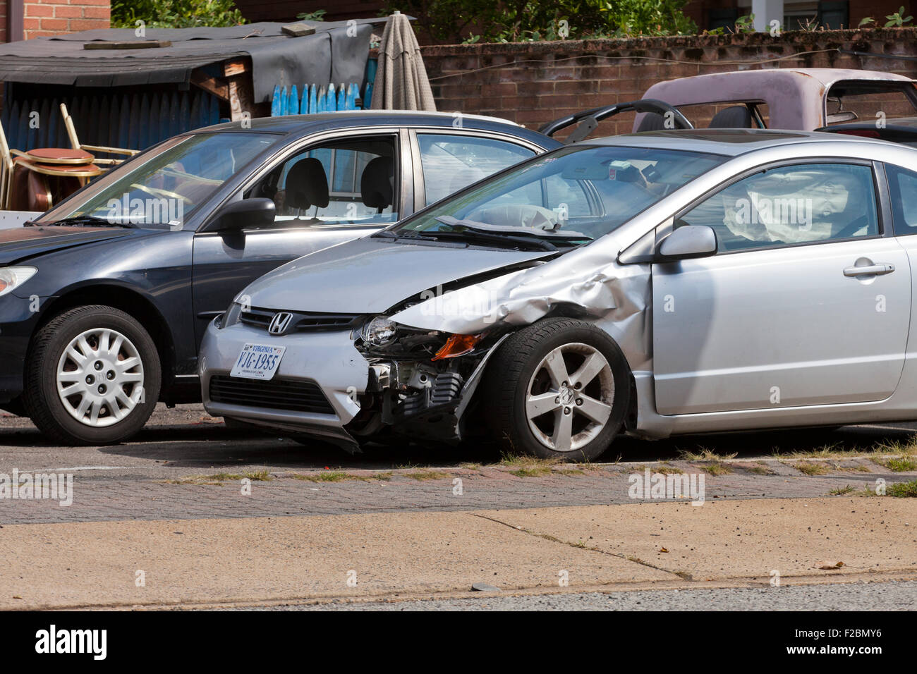 Car with front fender collision damage - USA - Stock Image