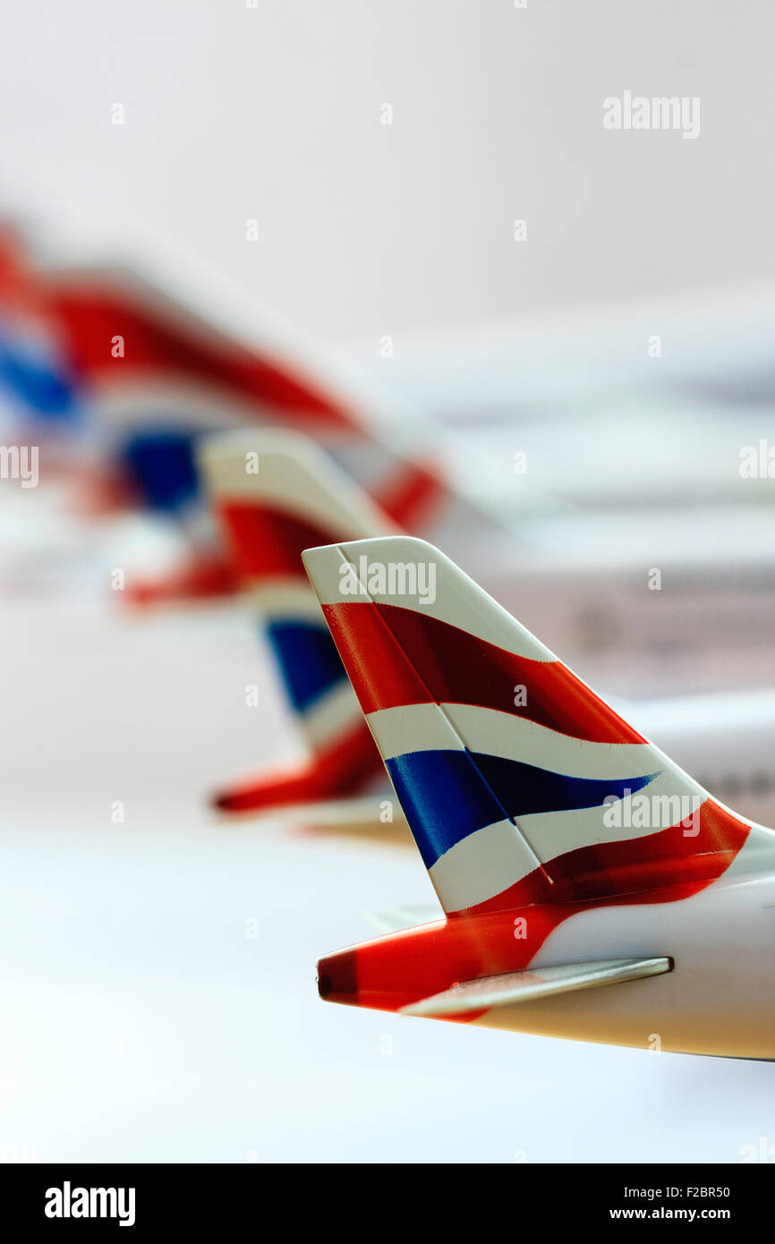 Metal kit models of British Airways planes, tail sections with United Kingdom, Union Jack flag in a line, row - Stock Image