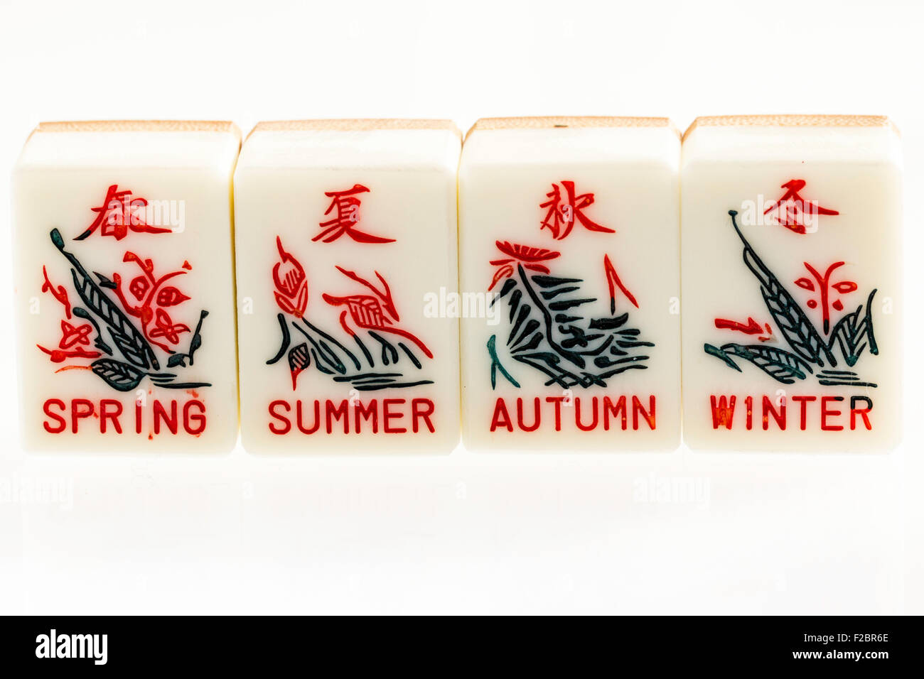 Malaysia or Singapore, Mahjong set, season set of cards or tiles, spring, summer, autumn and winter on plain white - Stock Image