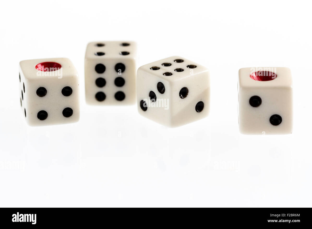 Four dice on plain background` - Stock Image