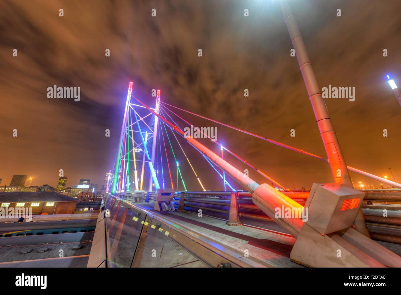 Nelson Mandela Bridge at night. The 284 metre long Nelson Mandela Bridge, starts at the end of Jan Smuts Avenue - Stock Image