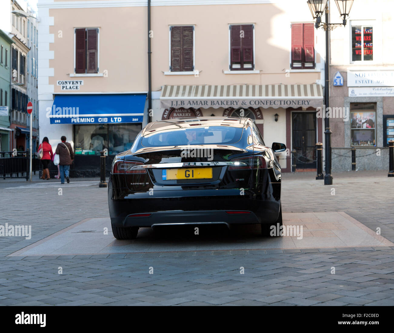 G1 registration plate Chief Minister official car Tesla Signature Model S , Gibraltar, British territory in southern Stock Photo