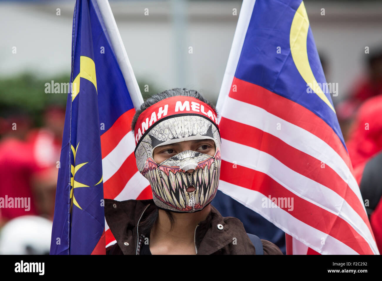Kuala Lumpur, Malaysia. 16th Sep, 2015. A pro-government protester takes part in a demonstration in Kuala Lumpur, - Stock Image