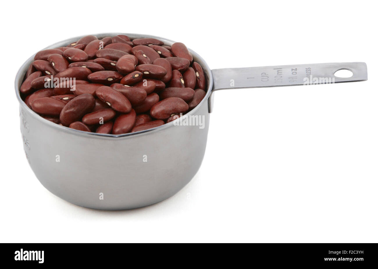 Red kidney beans in an American measuring cup, isolated on a white background Stock Photo