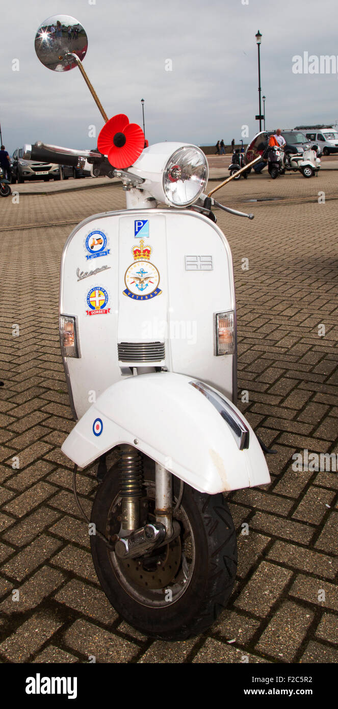 A Vespa motor scooter pictured on the seafront at Ryde, Isle of Wight. - Stock Image