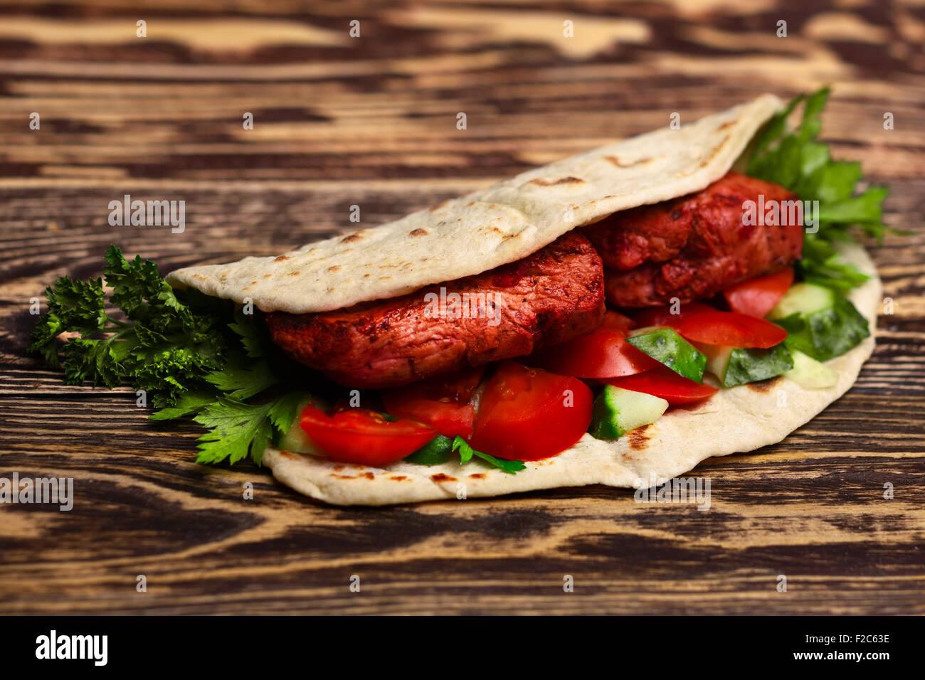 Chicken Tikka masala naan sandwich. Indian takeaway - Stock Image
