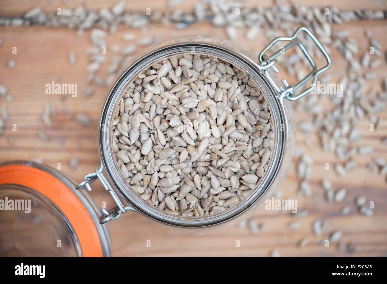 Helianthus annus. Sunflower seeds in a kilner storage jar - Stock Image
