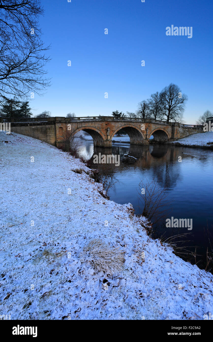 Winter snow at Chatsworth House, river Derwent, home of Duke of Devonshire, Peak District National Park, Derbyshire, - Stock Image