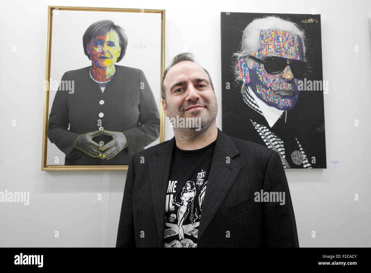 Berlin, Germany. 16th Sep, 2015. Artist Ariel Shallit poses in front of his works at the art fair 'Berliner Liste' Stock Photo