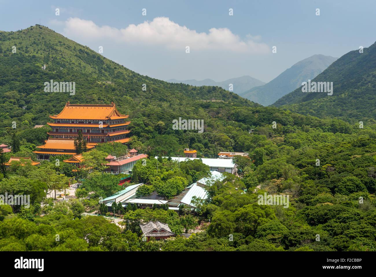 Tian Tan buddhist monastery at Ngong Ping village on Lantau island in Hong Kong SAR - Stock Image