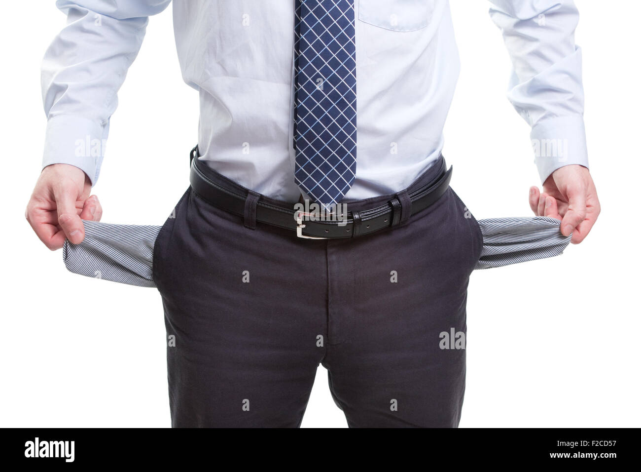 Broke business man with empty pockets isolated on white - Stock Image