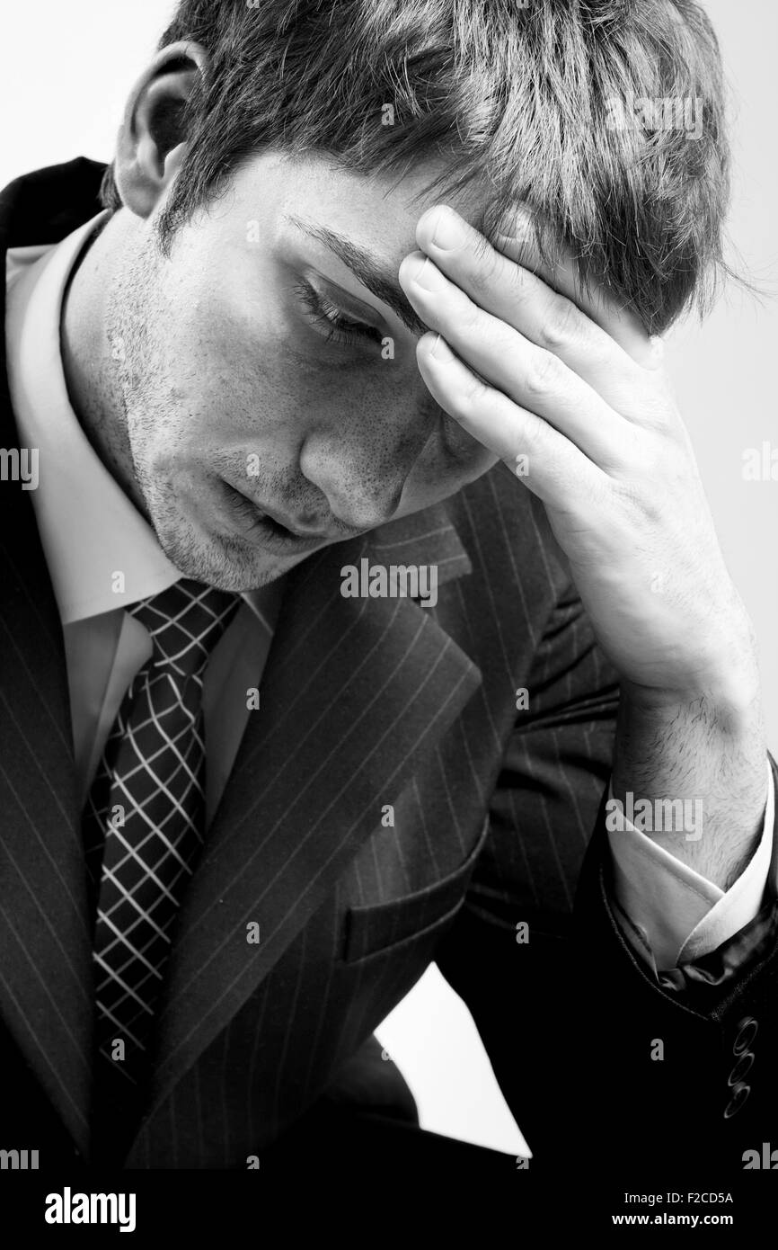 Portrait of depressed sad tired business man - Stock Image