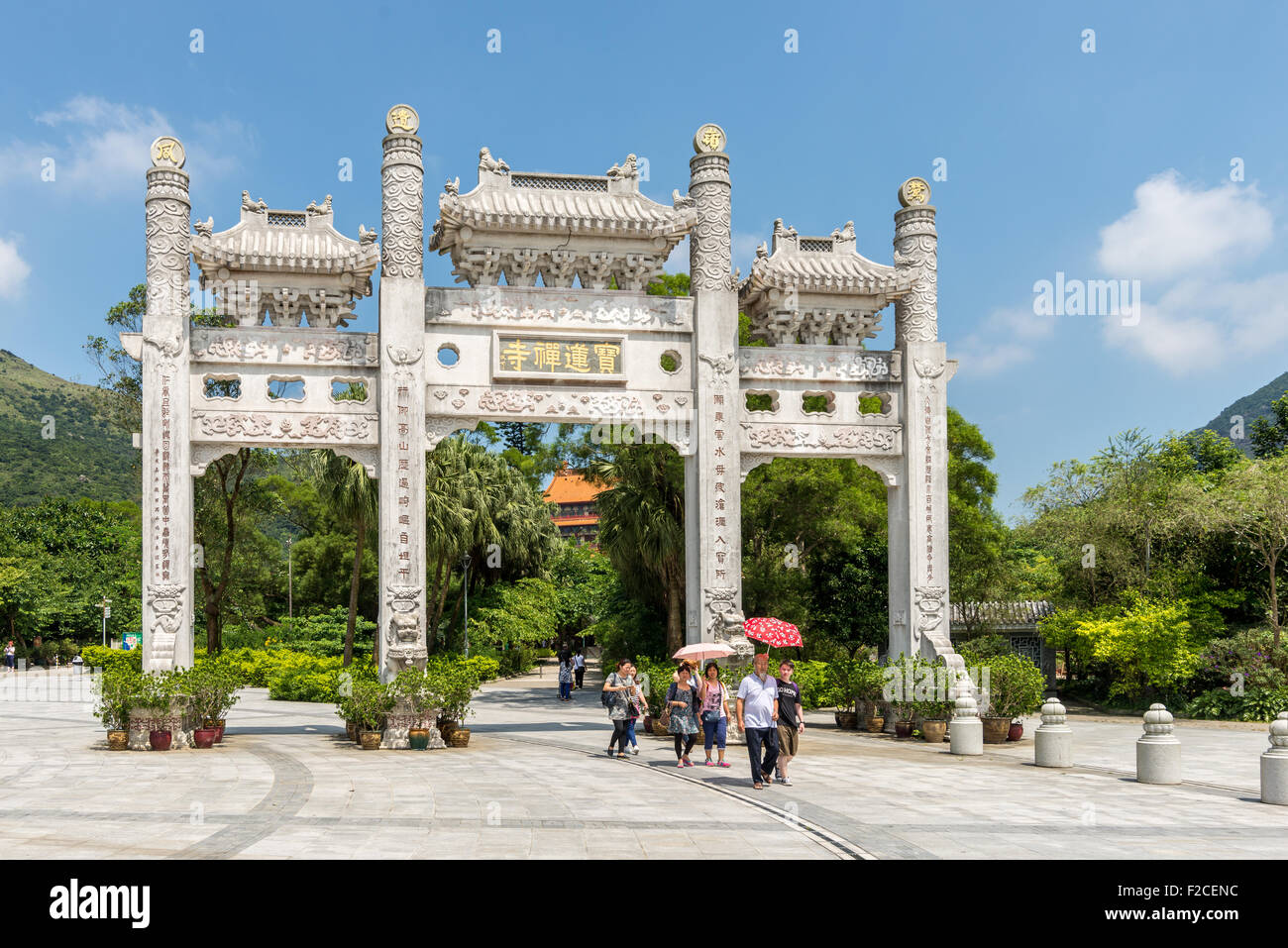 Entrance gate and walkway to Tian Tin monastery and the Big Buddha at Ngong Ping village on Lantau Island, Hong - Stock Image