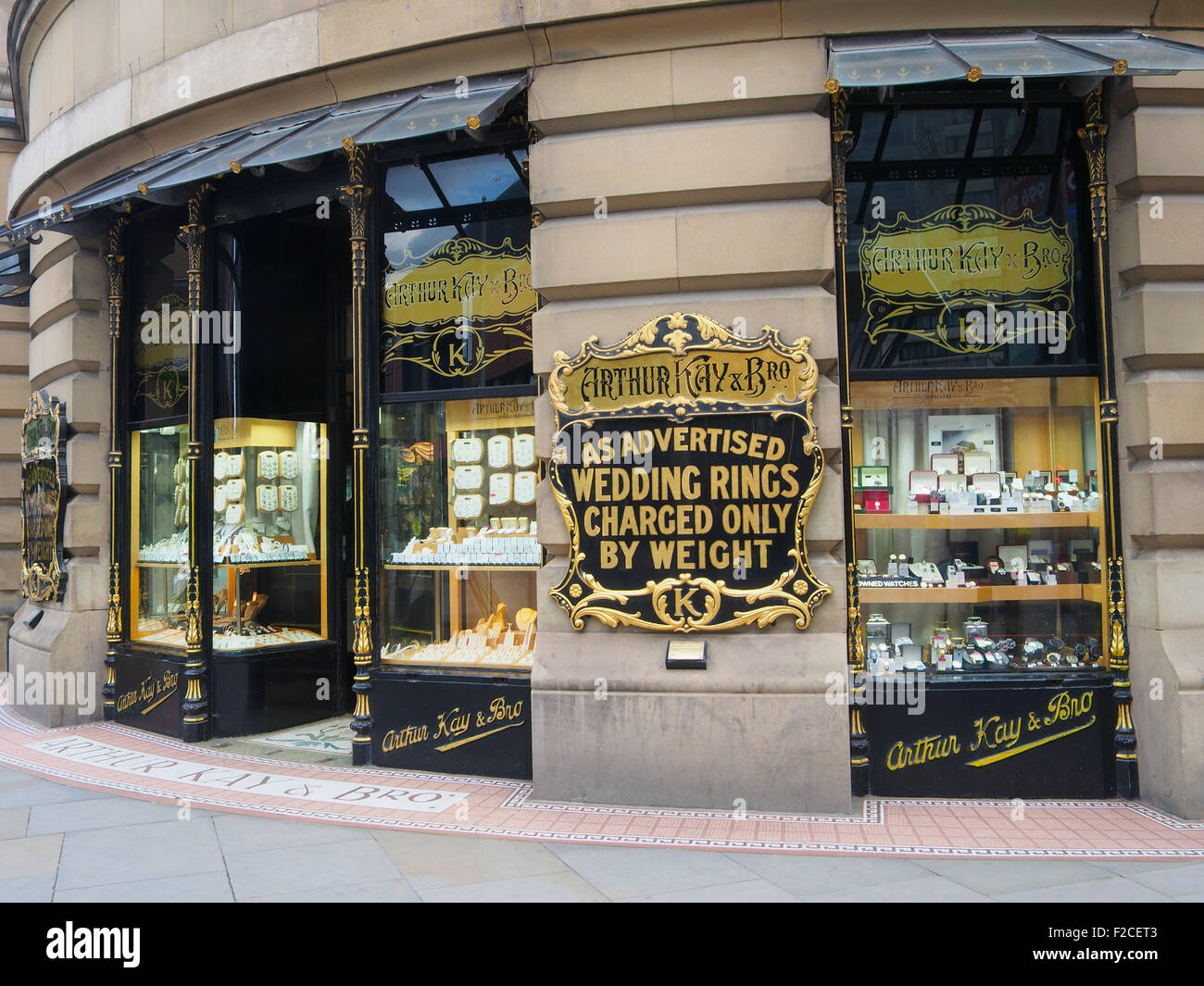 Shop window display of a jewellers specializing in gold in Manchester, city centre, UK. - Stock Image