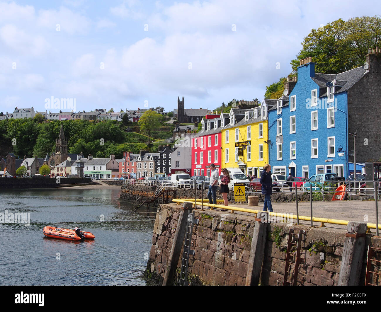 Colourful village of Tobermory showing the quay and sea with the shops and houses on the island of Mull, Scotland, - Stock Image