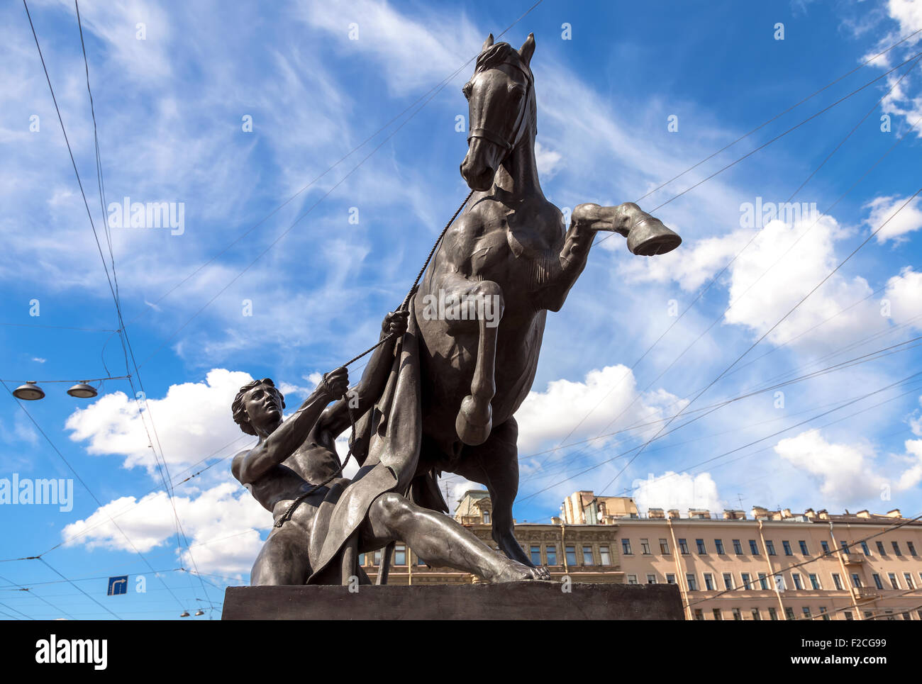 Sculpture tamer of horses, designed by the Russian sculptor Baron Peter Klodt.  Anichkov bridge, St. Petersburg, - Stock Image