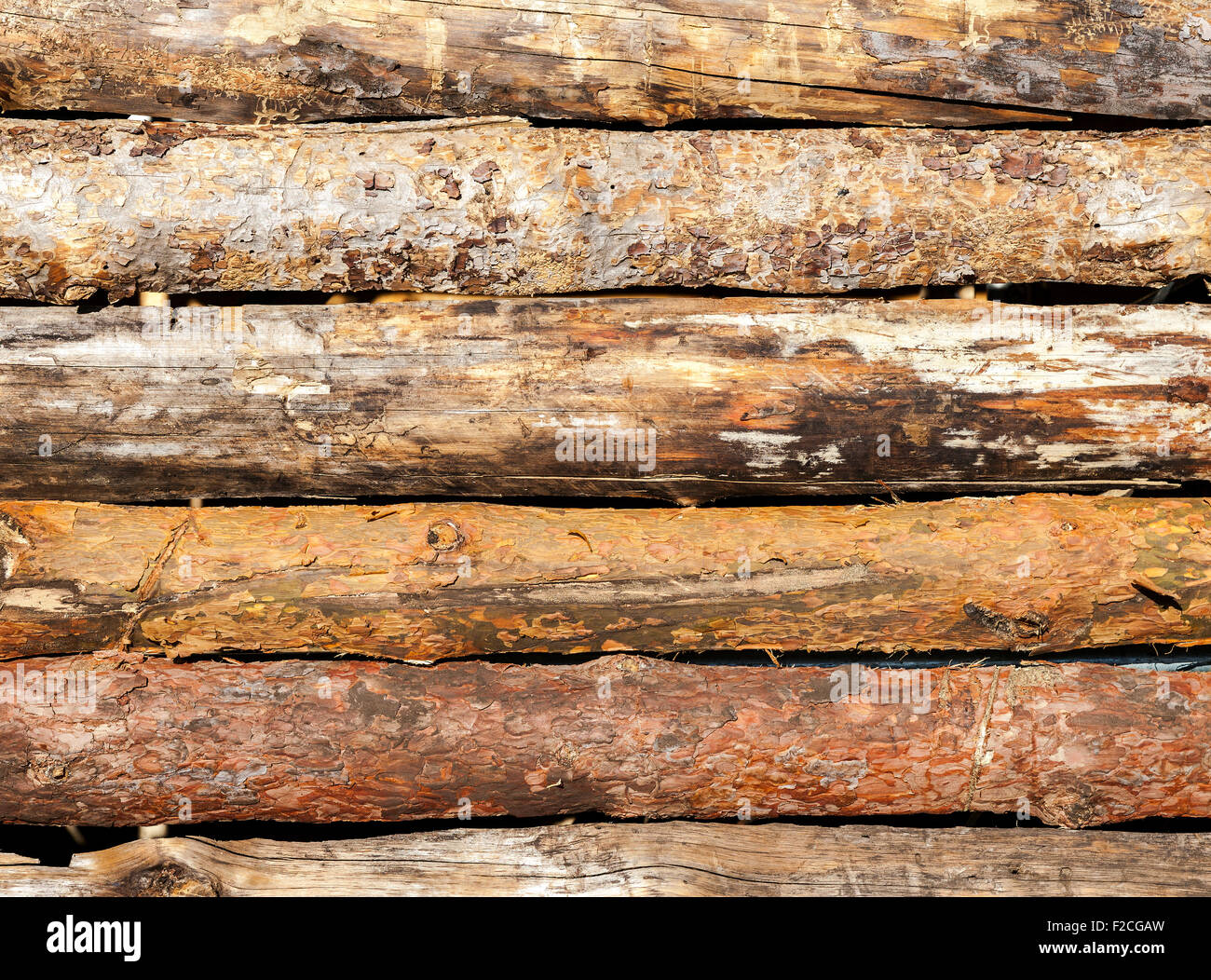 Old rough wooden planks with cracks as background - Stock Image