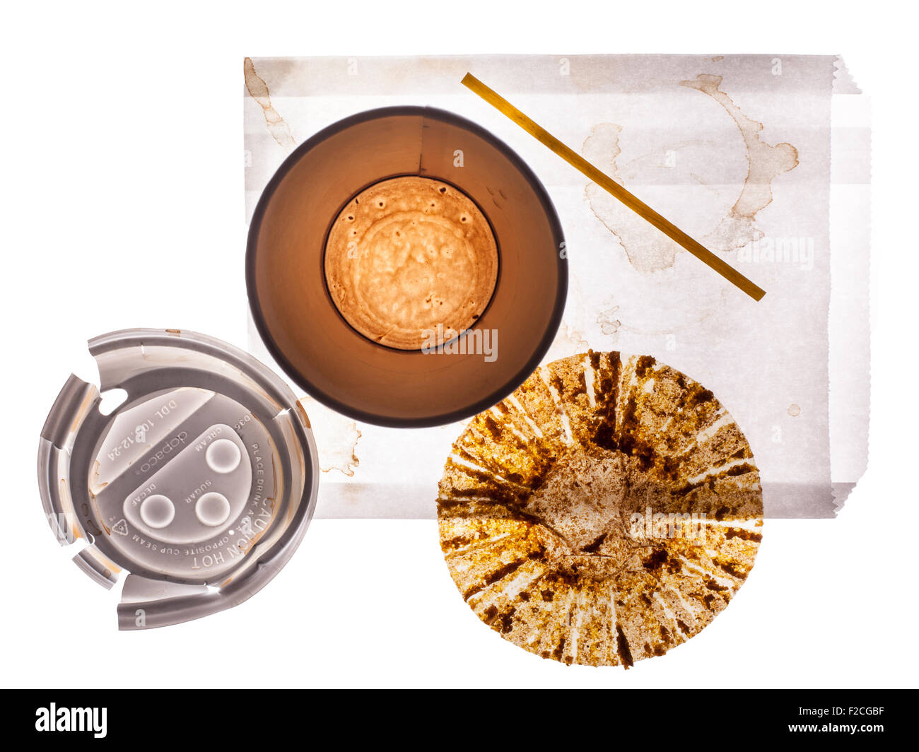 overhead view of empty paper coffee cup, lid, empty muffin wrapper, stir stick, white paper bag - Stock Image