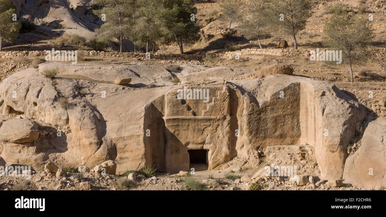 Nabataean stone tombs in Wadi Musa just outside the main ruins of Petra Jordan Stock Photo