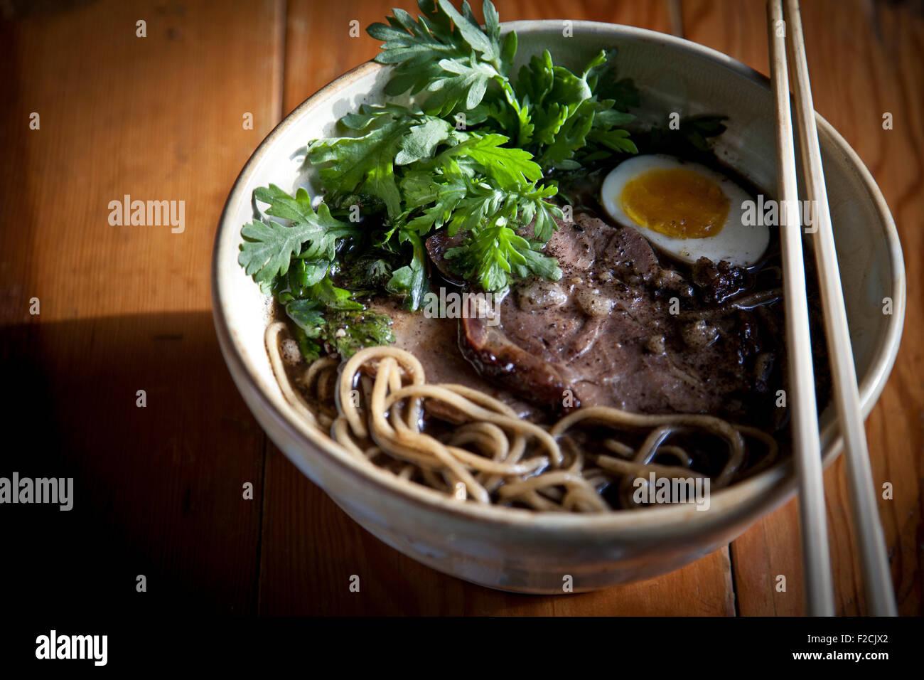 Kogashi miso ramen with ground pork belly, shoyu marinated egg, chanterelle mushrooms and shungiku, - Stock Image